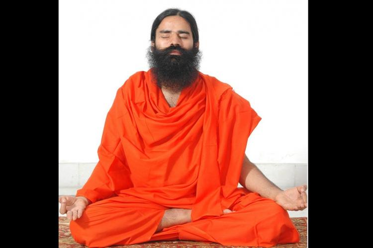 Baba Ramdevs yoga guide to solving the biggest problems of our time