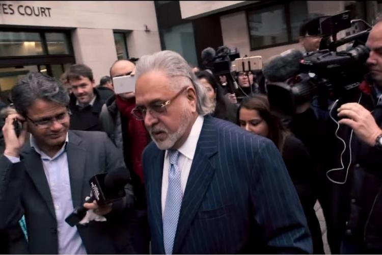 Vijay Mallya surrounded by reporters in London