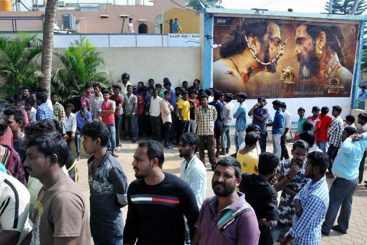 Movie fans wait at a theatre in Chikmagalur to watch the Bahubali 2