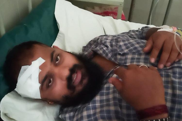 Assault victim Anil Poojary in hospital