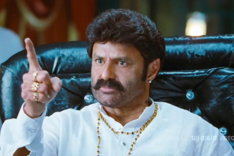 A still from Balakrishna s 2014 film Legend where he is looking at someone angrily with his finger raised
