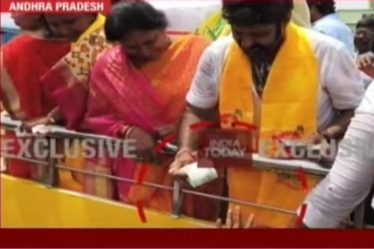 Andhra MLA Balakrishna caught on camera allegedly giving cash to voters in Nandyal