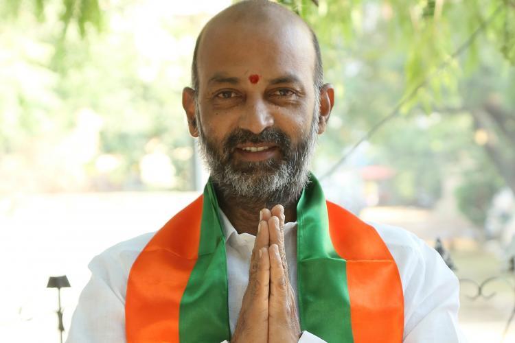 Bandi Sanjay Kumar folding his hands and greeting people