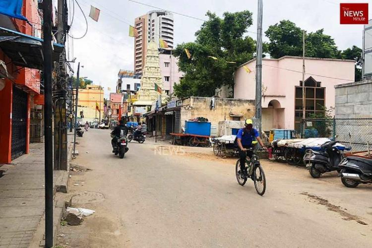 A cyclist rides his bicycle on a nearly empty street in Bengaluru during lockdown 50