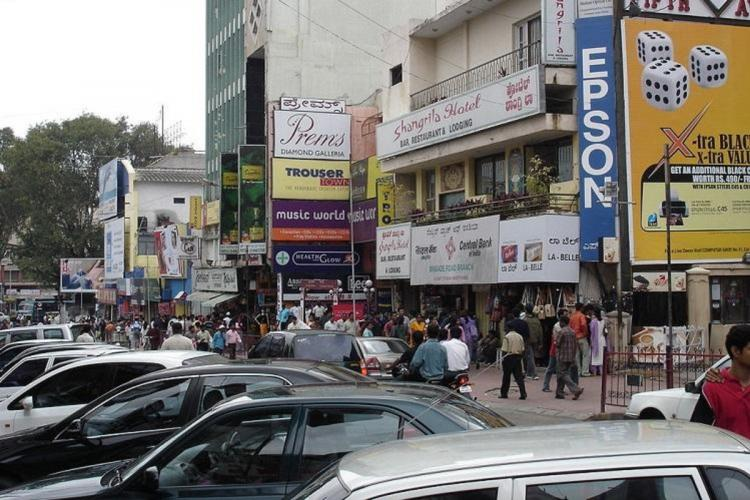 A file image of cars parked along Brigade Road in Bengaluru