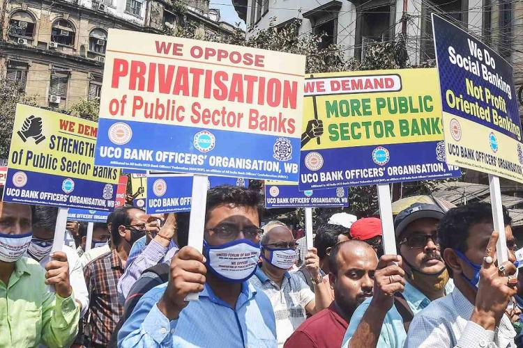 Bank employees holding up placards opposing the privatisation of banks