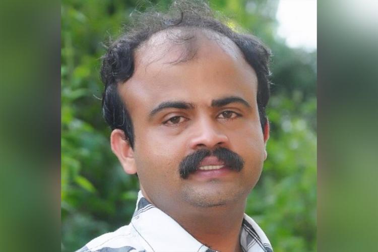A close up picture of photojournalist Dinesh Kottinje