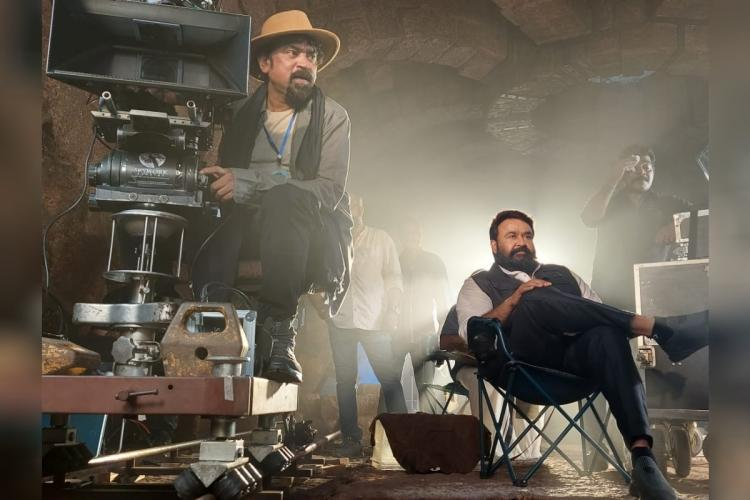 Mohanlal is seen watching the shoot while cinematographer Santosh Sivan is seen cranking the camera