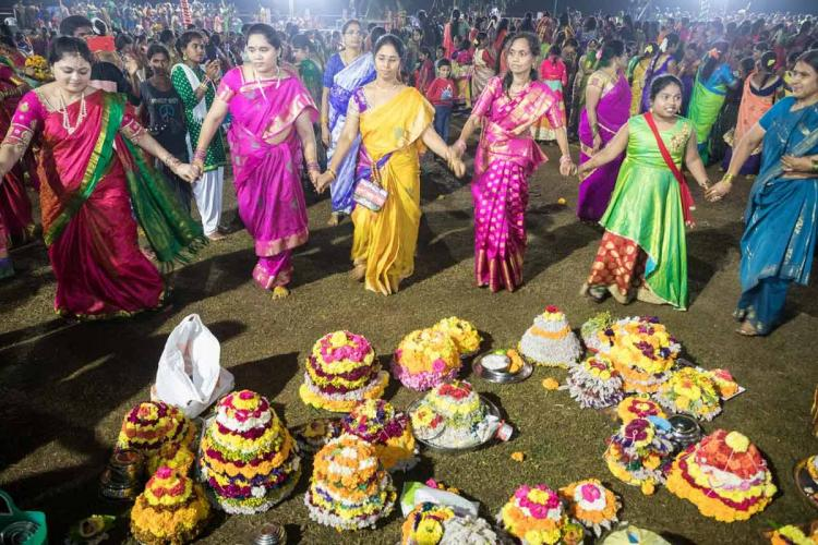 Bathukamma festival celebrations in which women are seen dressed in sarees and dancing