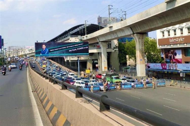 Commuters standing near Hyderabads Begumpet Barricade