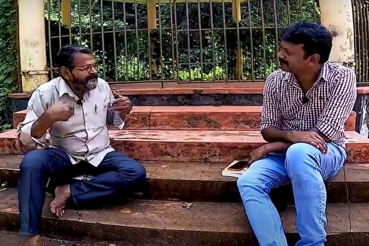 A video grab of the interview where the anchor (right) is interviewing Maniyan Pillai, the thief (Left). The two are sitting on a flight of stairs.