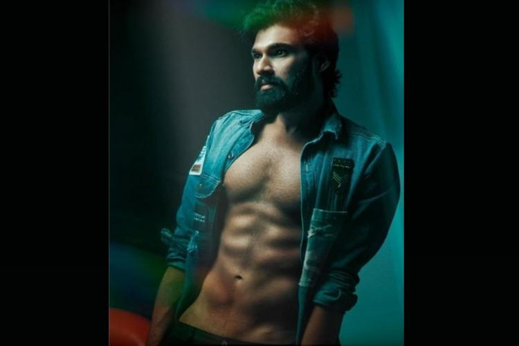 Bellamkonda Sai Srinivas posing for a picture with his six pack body and a blue coat