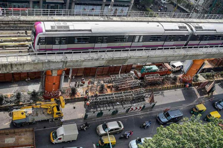 An aerial PTI photo of Bengaluru Metro and the vehicular traffic beneath