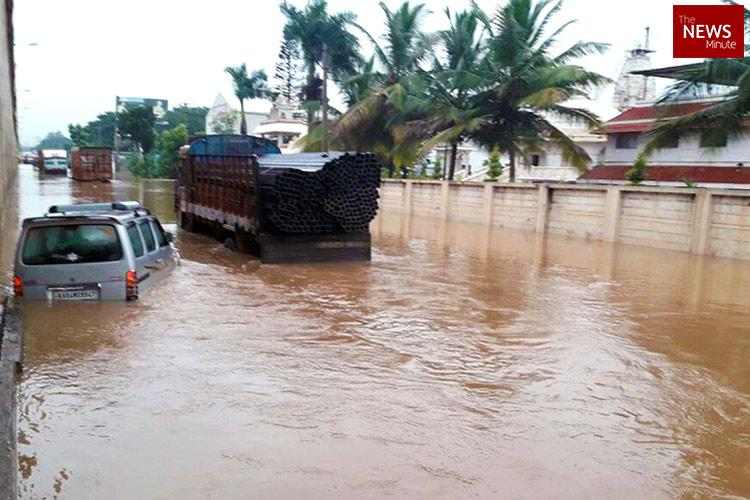Heavy rain in Karnataka wreaks havoc Two dead homes and roads flooded