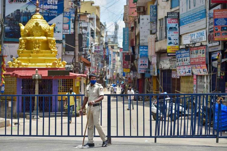 A policeman guards at Sadar Patrappa road locality in Bengaluru as Karnataka government announced the area under lockdown after detection of several clusters of coronavirus infections