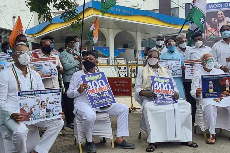 Congress protests against rise in petrol prices 100 not out led by DK Shivakumar and Siddaramaiah
