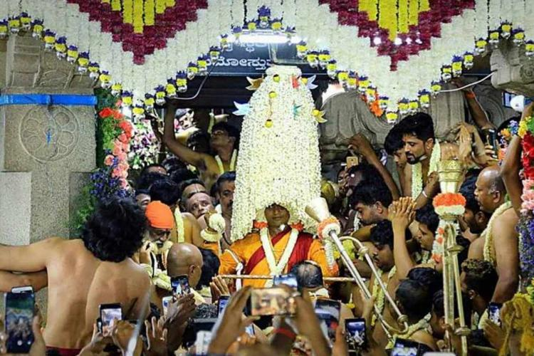 A representative image of the Bengaluru Karaga being carried from inside a temple