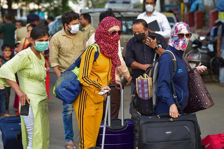 Group of travellers with their faces covered