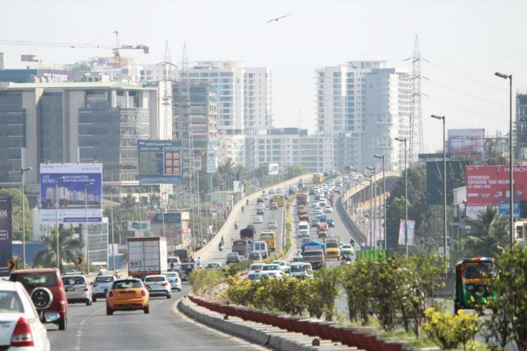 Bengaluru road with high-rises in the background