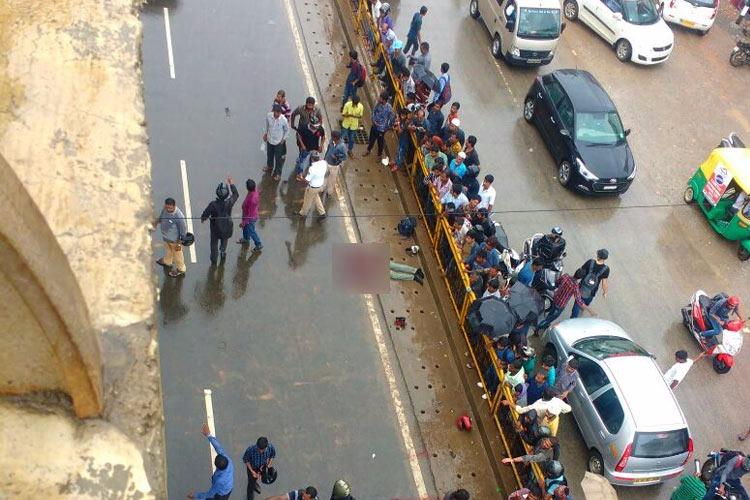 Two men thrown off a Bengaluru flyover and killed after their bike was hit by speeding cab