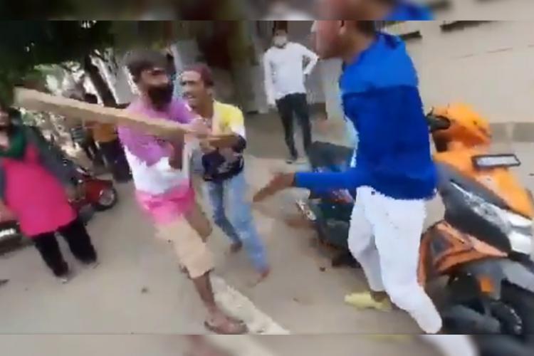 Screen grab of video showing Bengaluru men being beaten for performing bike stunts