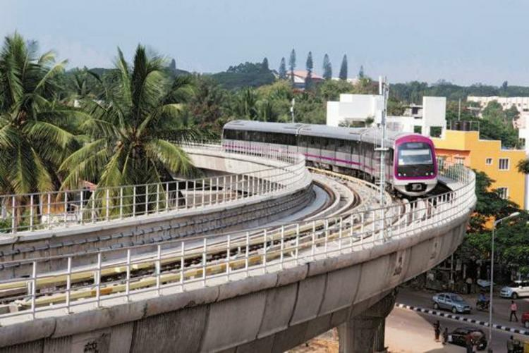 A file photo of a Namma Metro train running on the Purple Line track of the Bengaluru metro