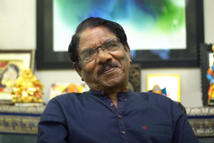 Tamil director Bharathirajaa in blue shirt and smiling