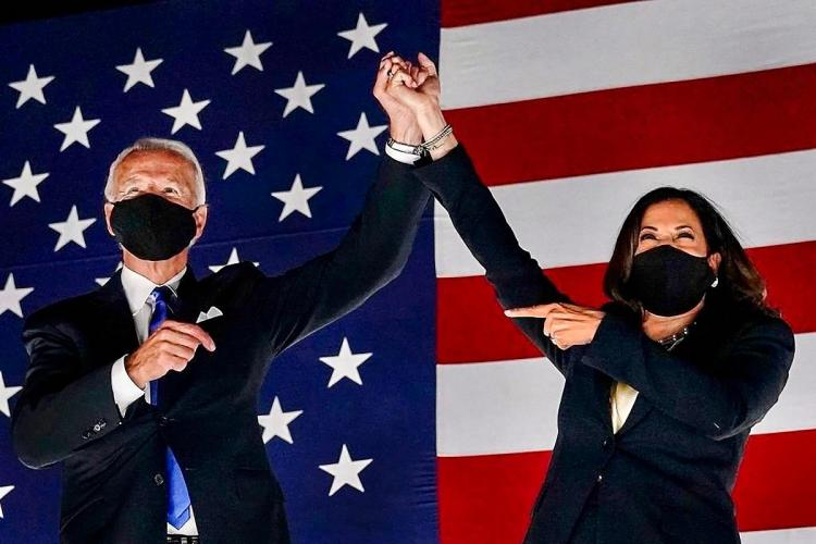 US President elect Joe Biden and Vice President elect Kamala Harris holds hands as they celebrate after winning the election