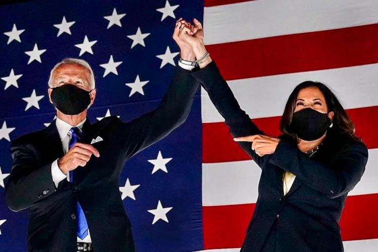 US President elect Joe Biden and VP elect Kamala Harris after winning the polls in front of US flag