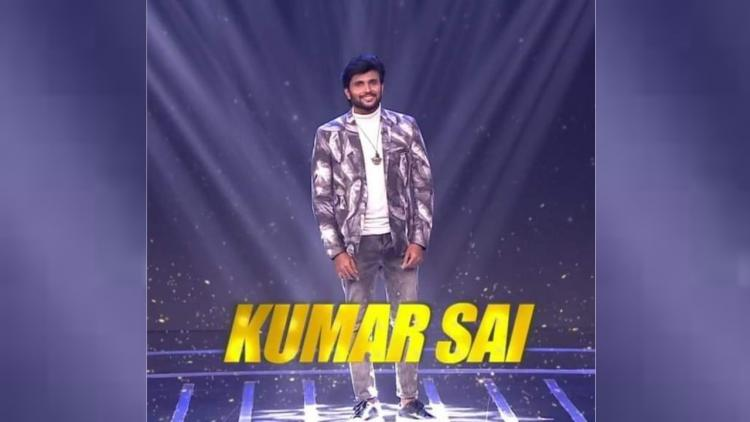 Kumar Sai, a Bigg Boss contnestant posing for a picture in a blue jacket and jeans
