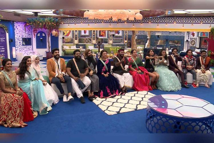 Bigg Boss Malayalam 3 candidates sit in a row listening to Mohanlal
