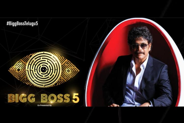 Bigg Boss season five poster in which Nagarjuna is seen sitting on a chair