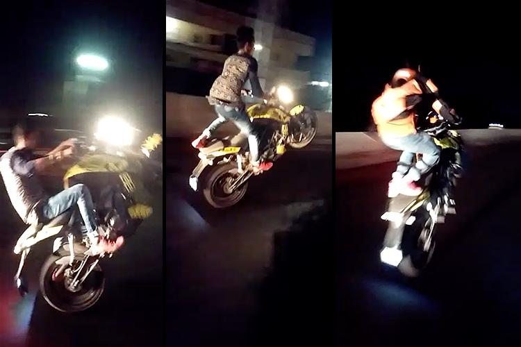 Watch Youths perform dangerous stunts on Vijayawada highway police assure action