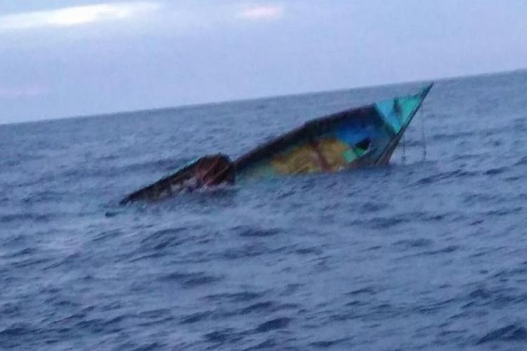 Boat sinking in sea