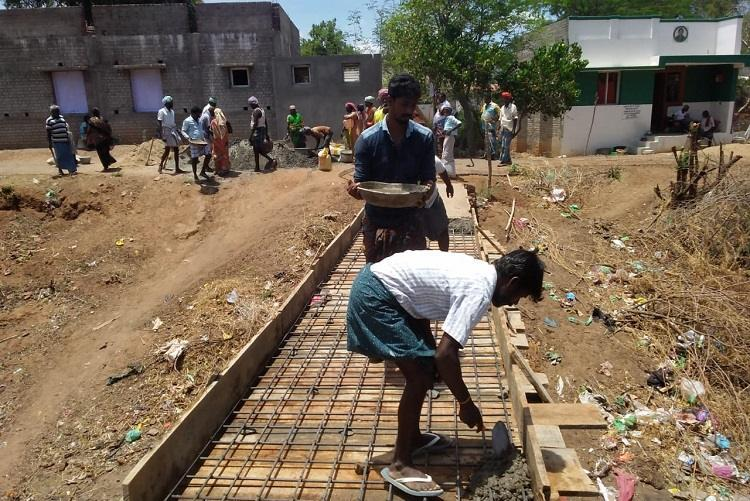 Faced with govt apathy 100 TN villagers join hands to rebuild a broken bridge