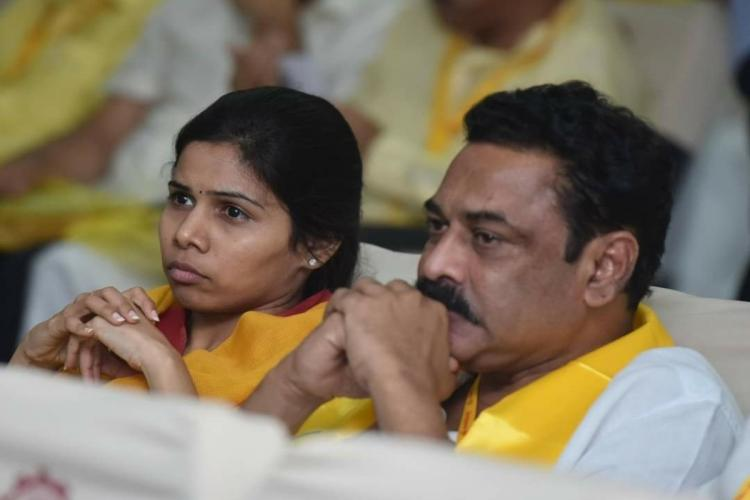 A photo of Bhuma Akhila Priya and her husband sitting next to each other during a TDP event