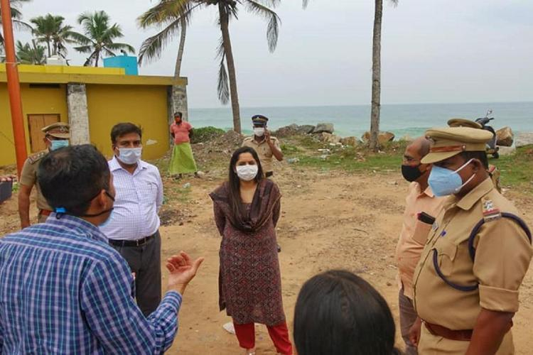 Collector Navjot stands in the middle with her team including police at a coastal area