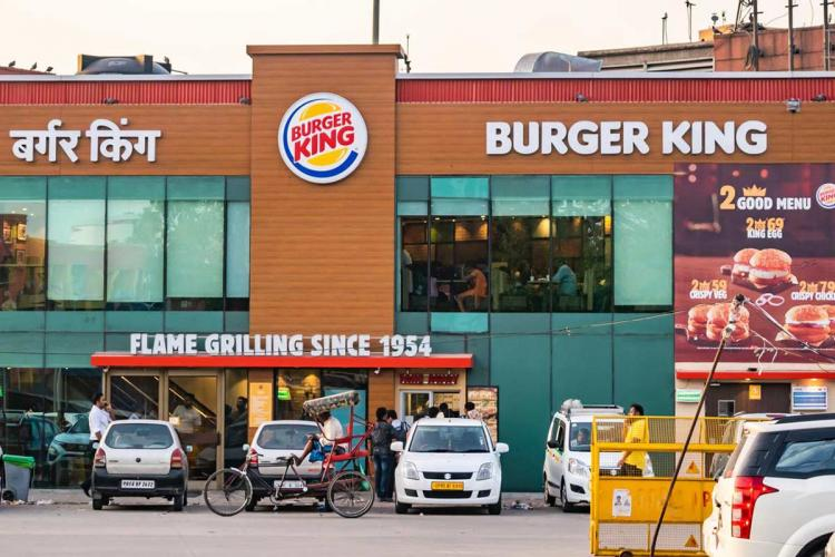 Burger King lists on BSE at 9225 premium Sensex touches new high