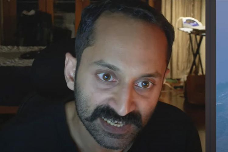 Semi bald man with mustache speaks angrily sitting in his room