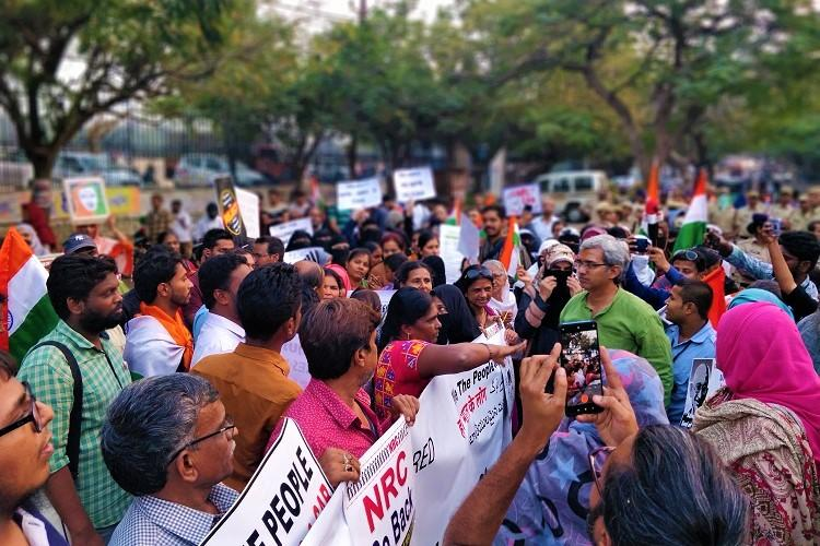 Hundreds form human chain unfurl national flag against CAA-NRC in Hyderabad
