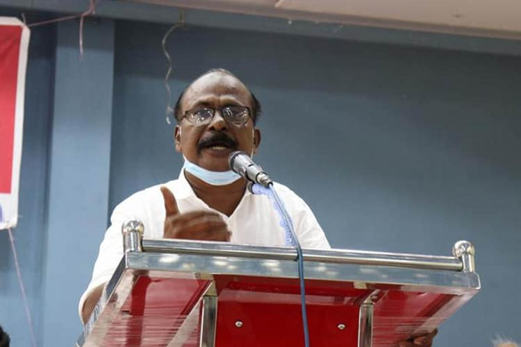 CPI leader CC Mukundan speaking at an event