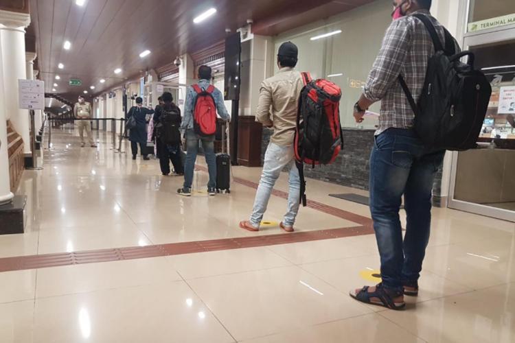 Passengers waiting in queue for screening at cochin International Airport in Kerala
