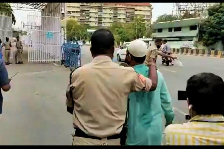 Police rescue a man who attempted to kill himself outside the residence of the Telangana Chief Minister
