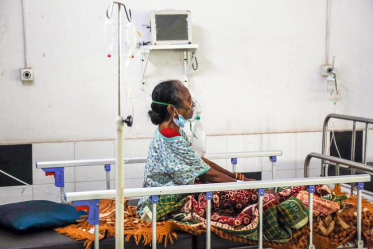 A patient in a hospital on oxygen supply