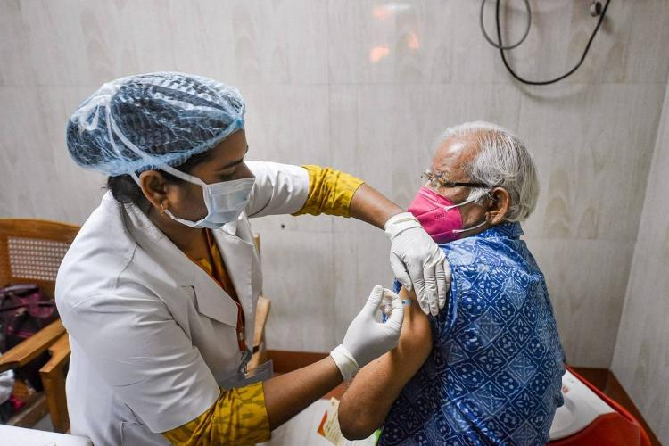 An elderly man getting the COVID-19 vaccine