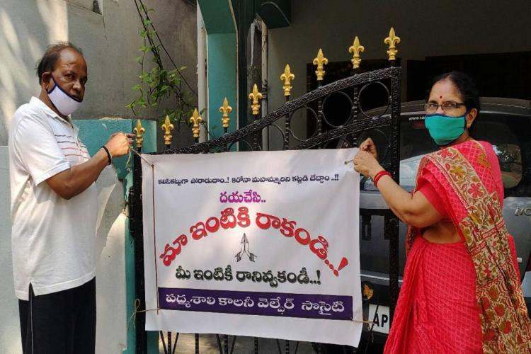 Residents placing flex banner with COVID-19 caution on their gate