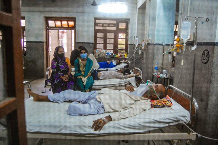 Patients undergo treatment for COVID at a hospital in Kanpur