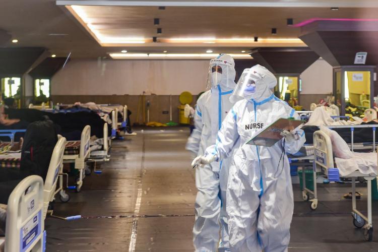 Medics inspecting patients at a COVID isolation ward