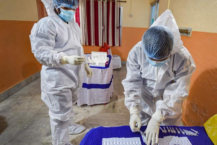 Frontline workers during the coronavirus pandemic wearing full PPE kits