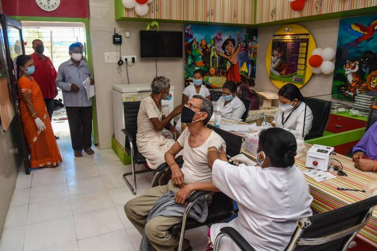 Beneficiaries receiving the second dose of COVID-19 vaccine at a government dispensary in Patna